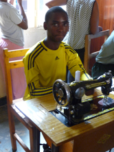 Boy with sewing machine, Ruanda